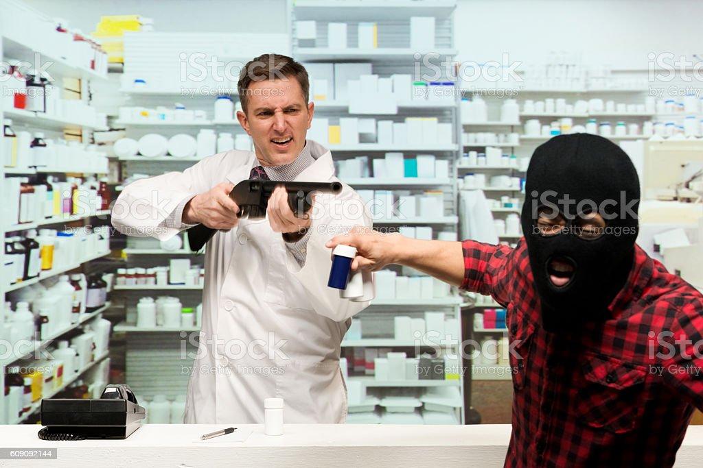 Pharmacists defending himself against robber stock photo