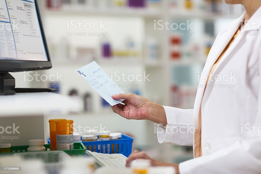 Pharmacists Fulfilling Prescription stock photo