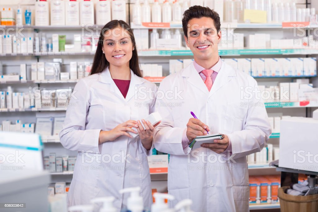 pharmacists  posing in drugstore stock photo