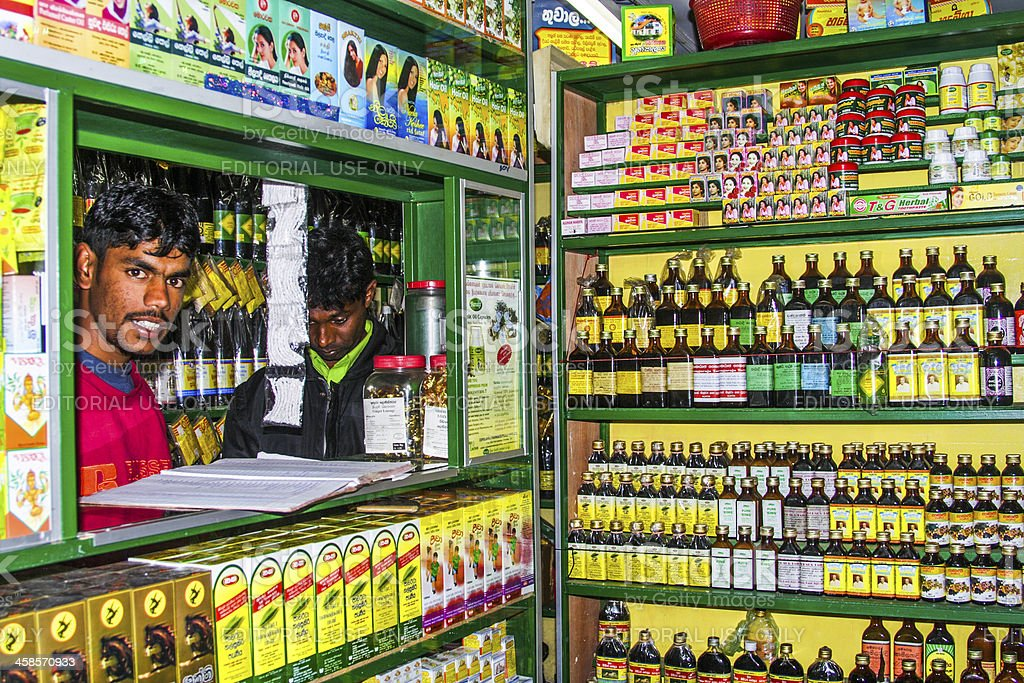 pharmacists sells medicine in his shop stock photo