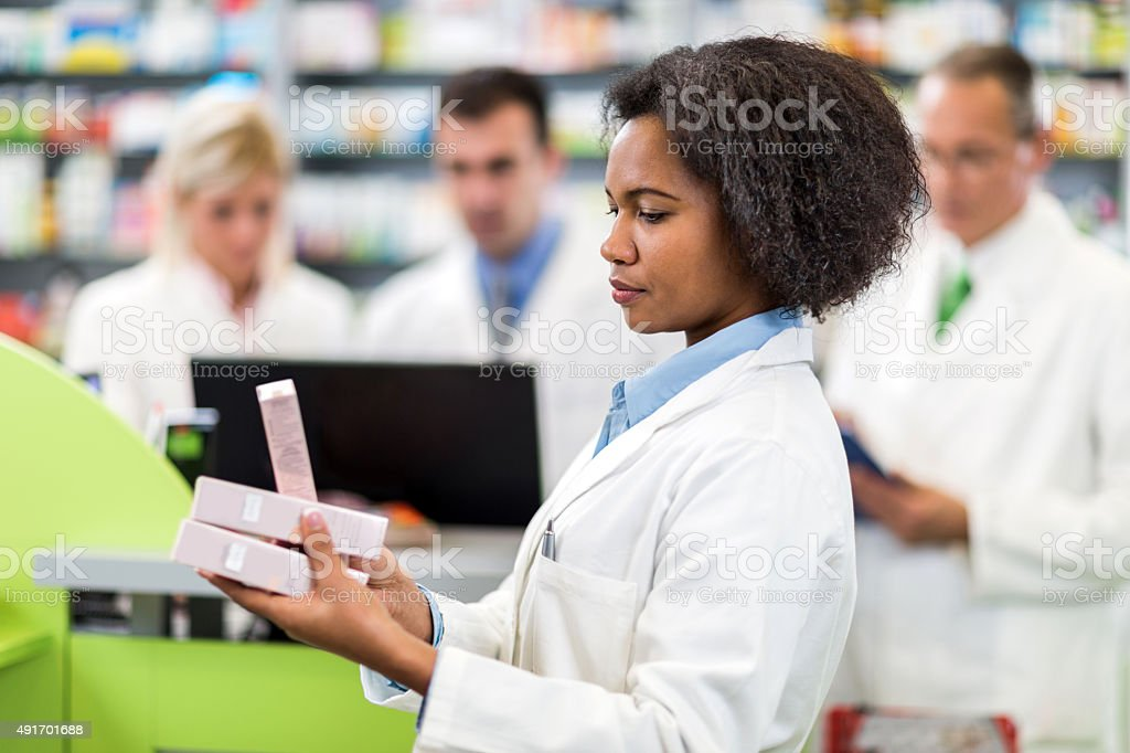 Pharmacists working in a pharmacy. stock photo