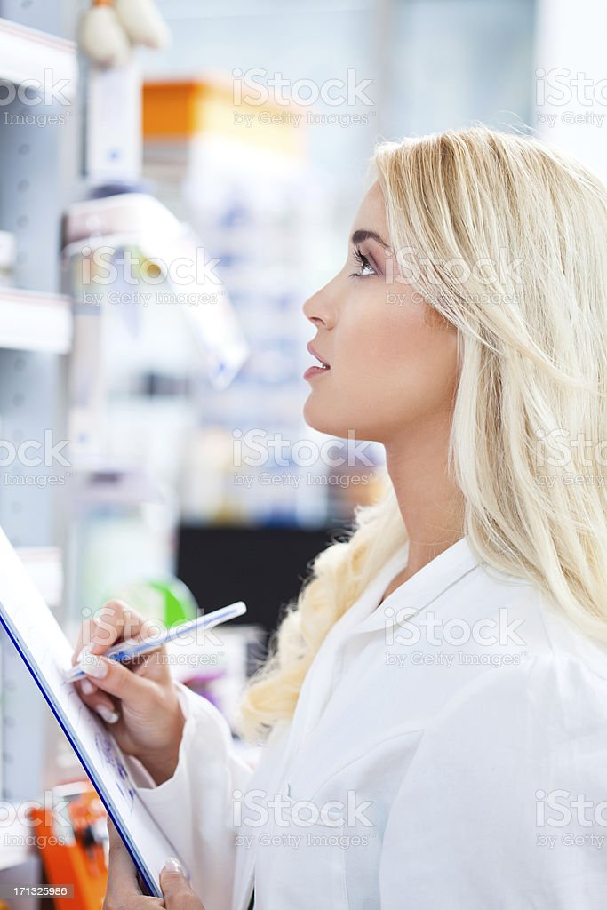 Pharmactist working in pharmacy royalty-free stock photo