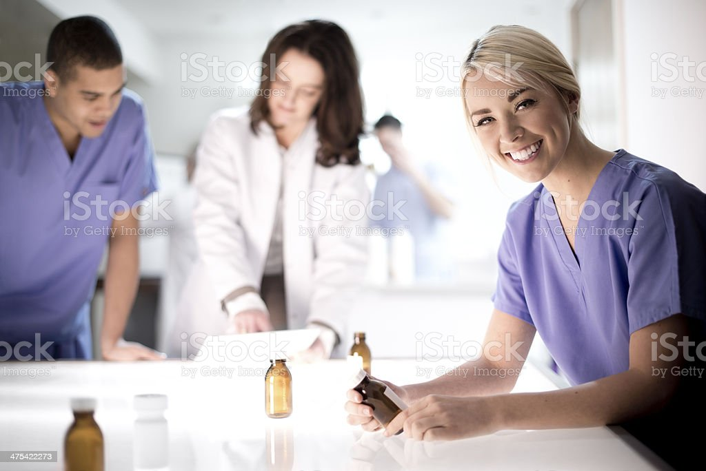 pharmacy assistant checking medicines royalty-free stock photo