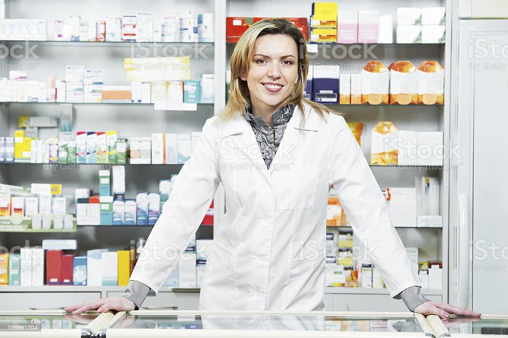 Pharmacy chemist woman in drugstore royalty-free stock photo