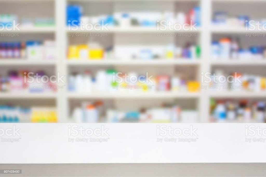pharmacy counter with blur shelves the pharmacy drugstore stock photo