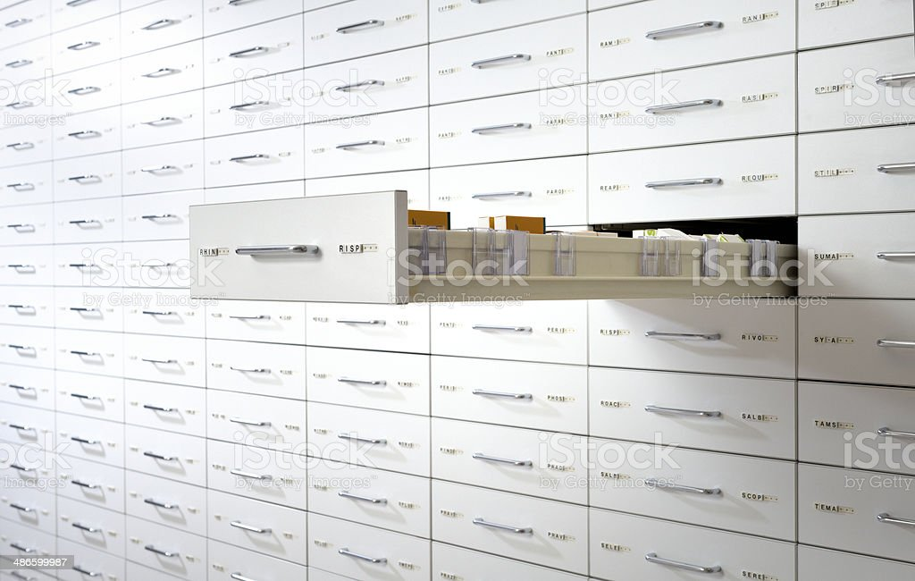 pharmacy medicine drawers wall stock photo