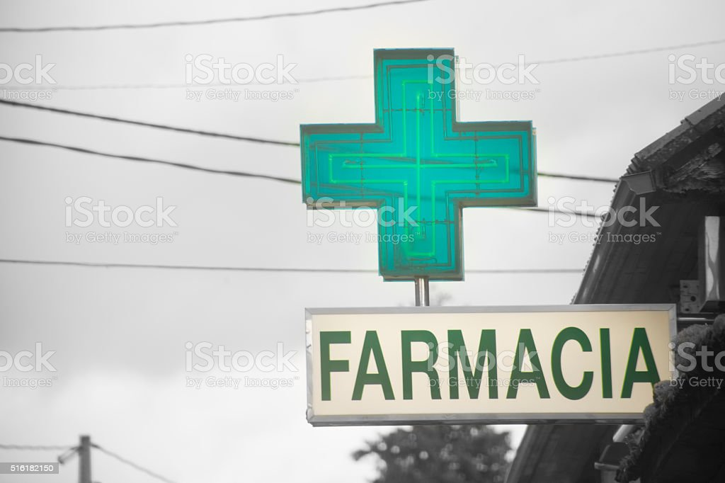Pharmacy sign and green cross stock photo