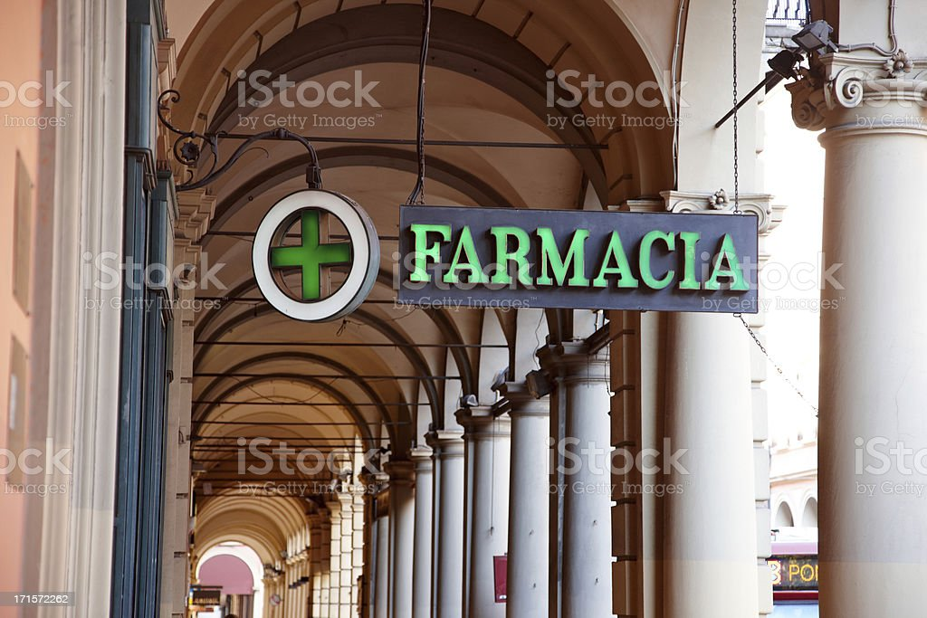 Pharmacy sign in old Bologna archway stock photo