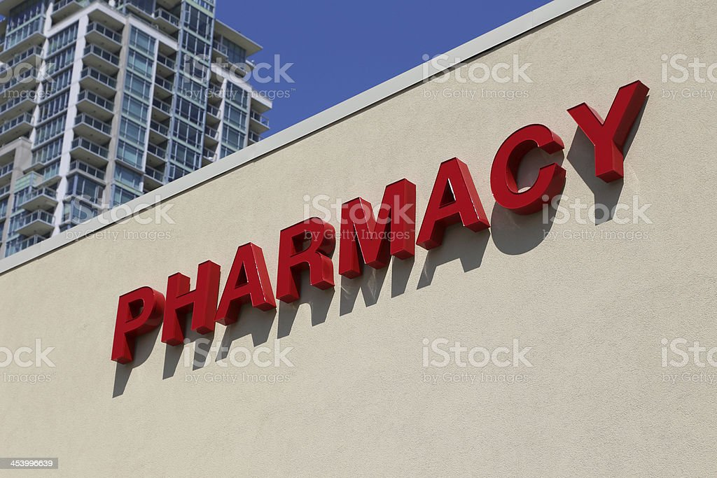 Pharmacy sign on wall stock photo
