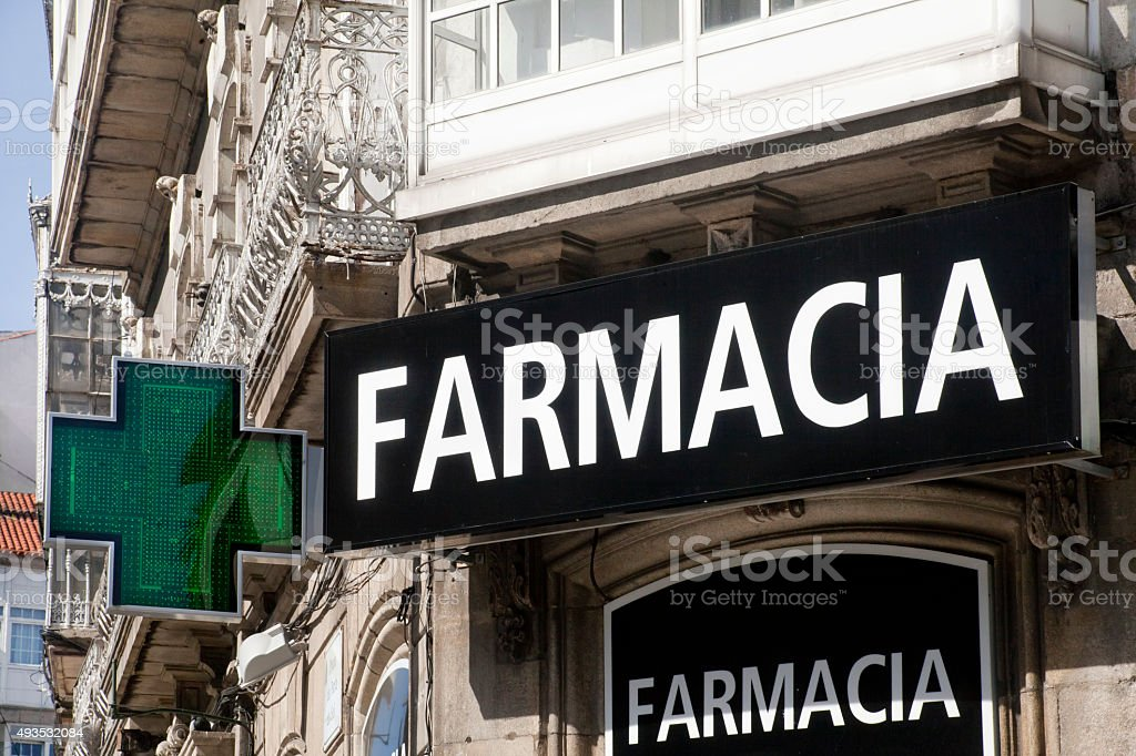 Pharmacy signs in spanish language and green cross. stock photo