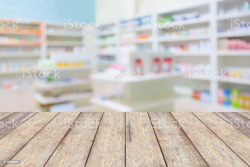 pharmacy store drugs shelves interior blurred background stock photo