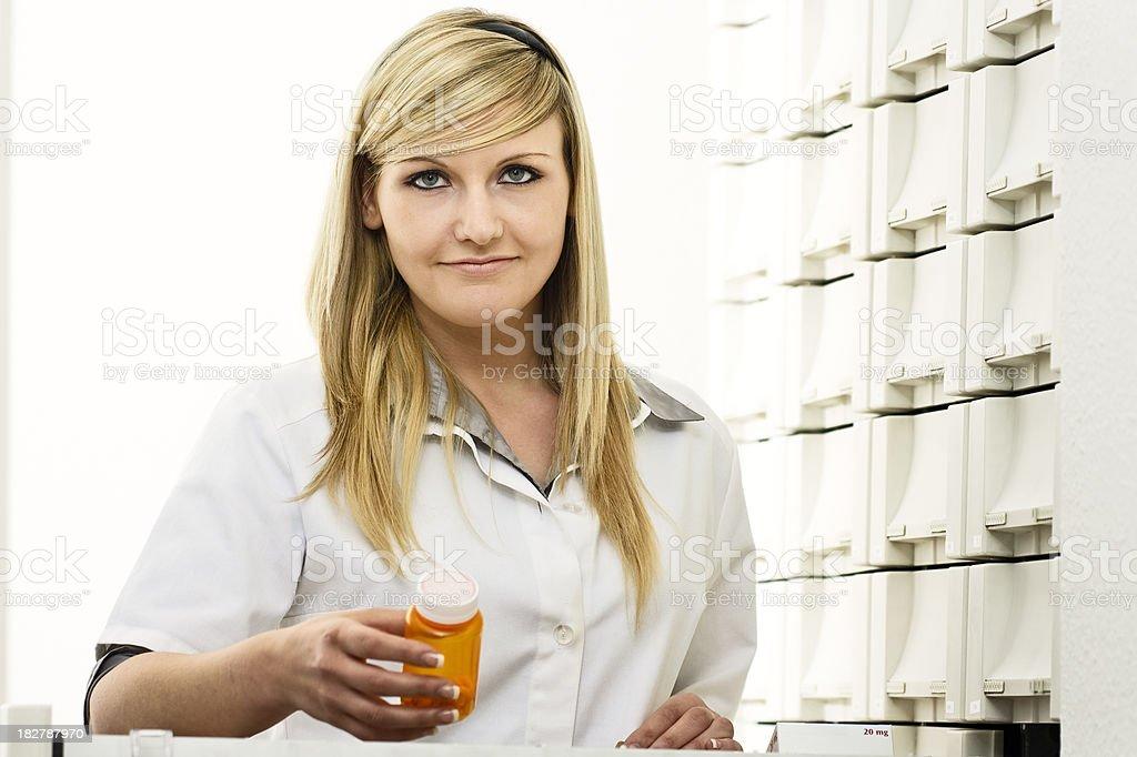 Pharmacy Technician Holding Prescription Medicine royalty-free stock photo