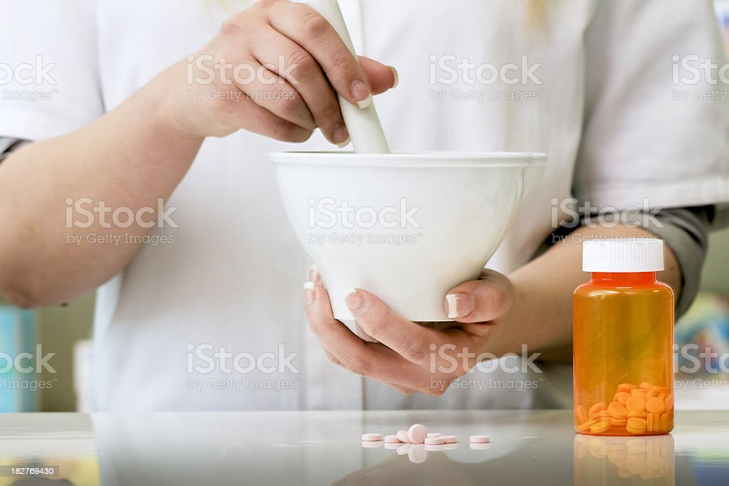 Pharmacy Technician With Mortar and Pestle royalty-free stock photo