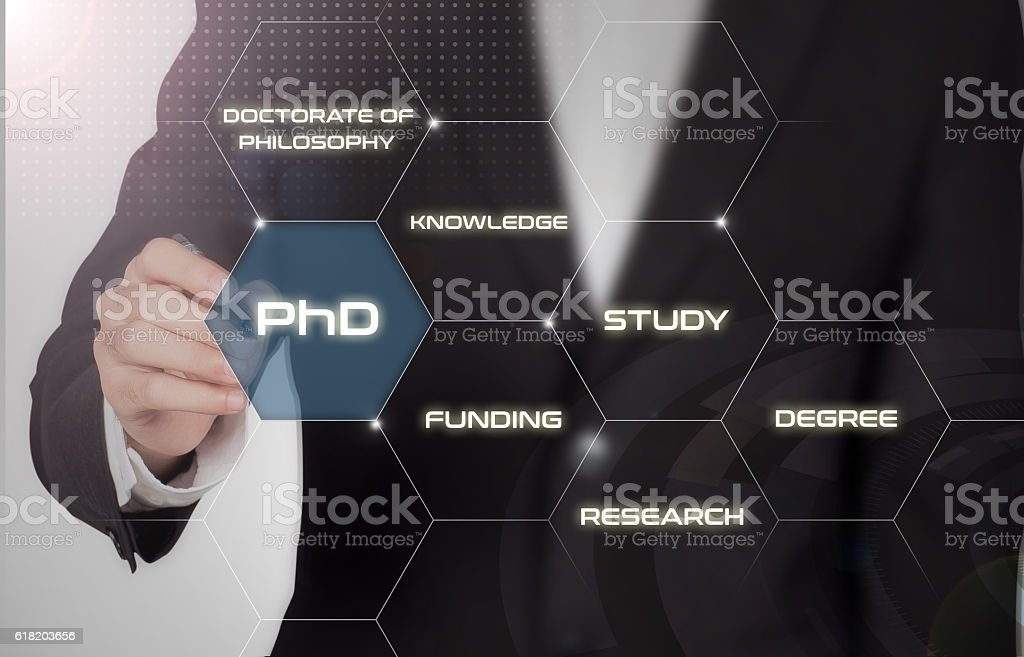 PhD student pushing button about Doctorate of Philosophy concept stock photo