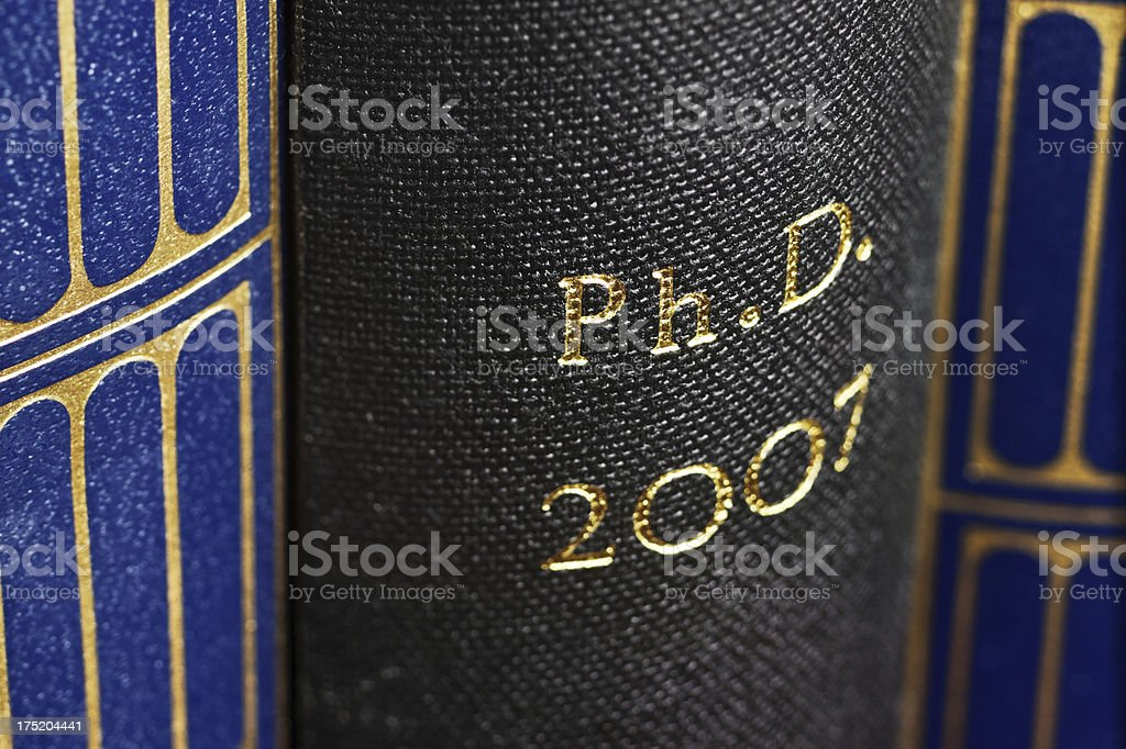 PhD thesis (Ph.D.) - Close-up of the book spine royalty-free stock photo