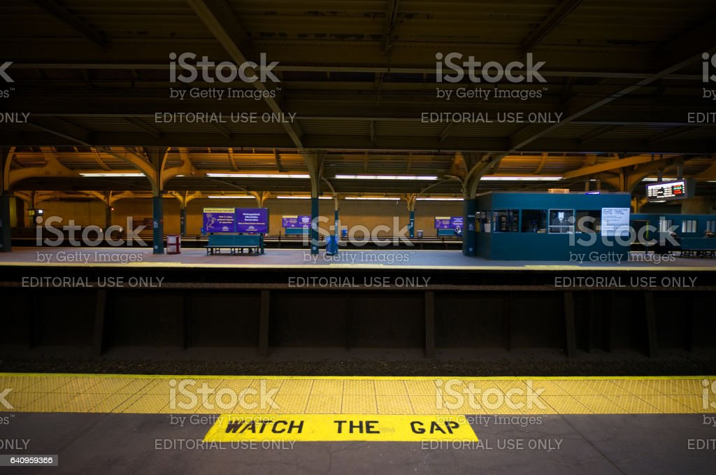 Philadelphia, PA, USA - January 29, 2017;  Platforms are empty at 30th Street Station in Philadelphia, PA. The station serves both regional SEPTA and Amtrak rail services and is one of the three main Center City transportation hubs, stock photo