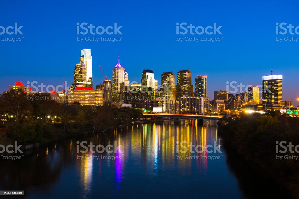 Philadelphia skyline and Schuylkill River at Dusk w/ Sunset Reflections stock photo