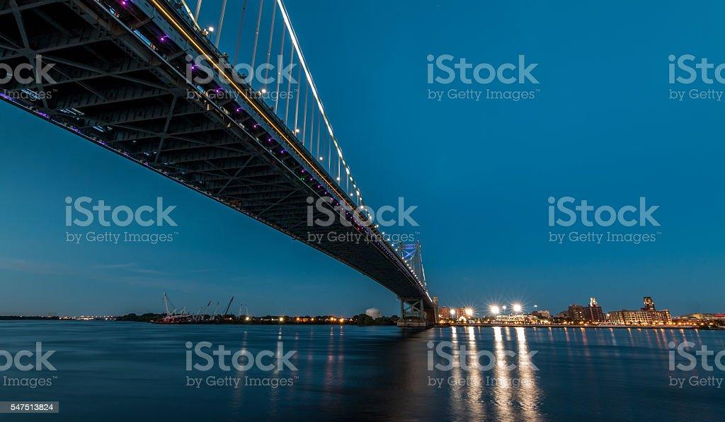 Philadelpia's Franklin Bridge crossing Delaware River at dusk stock photo
