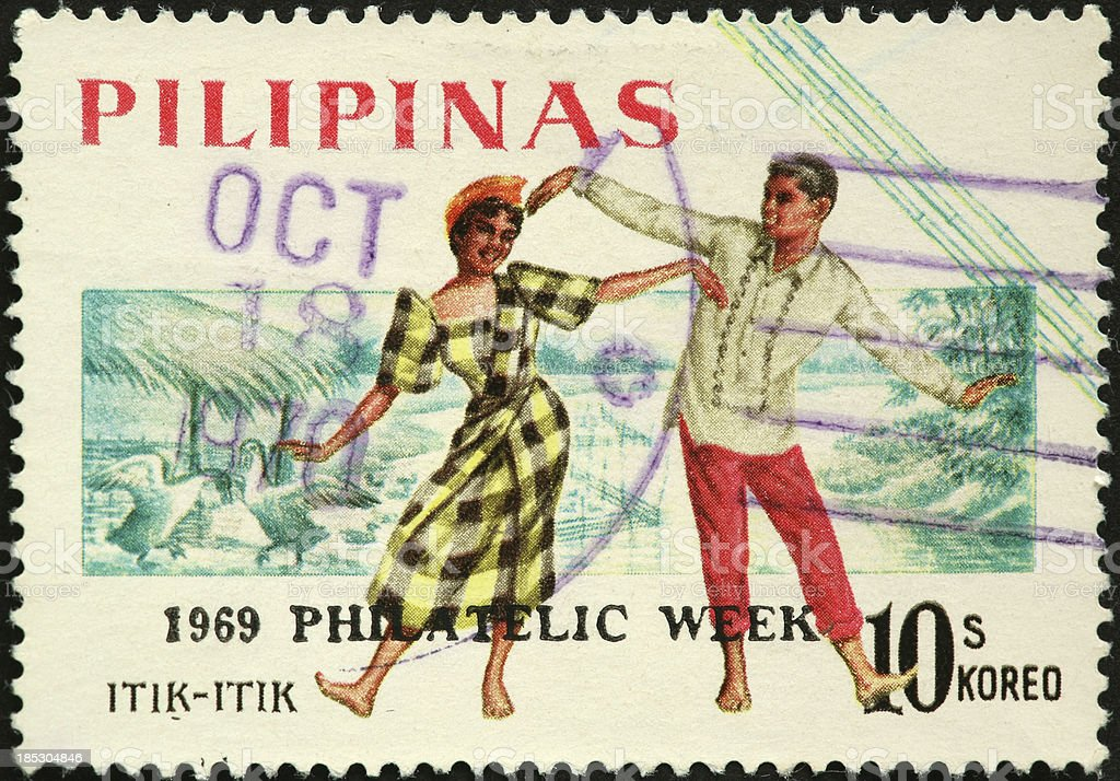 Philippine dancing couple on an old stamp stock photo