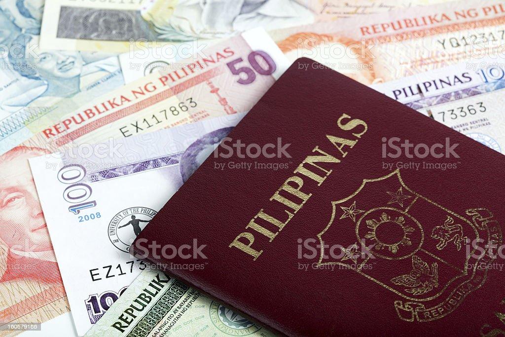 Philippine passport on peso stock photo