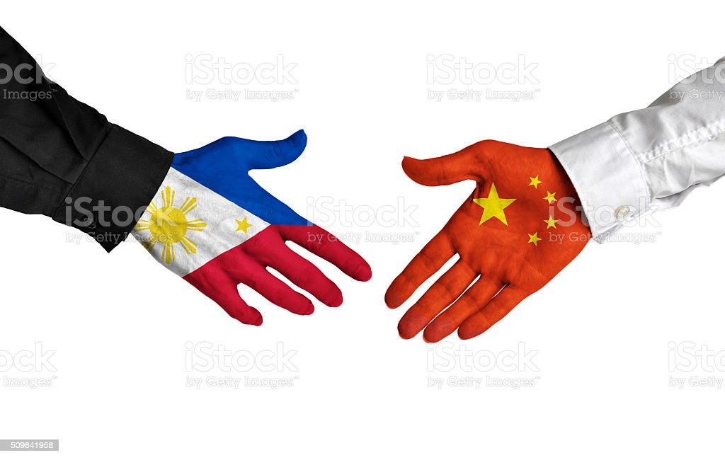Philippines and China leaders shaking hands on a deal agreement stock photo