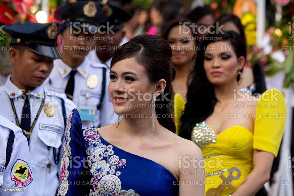 Philippines beauty queens escorted by security guards royalty-free stock photo