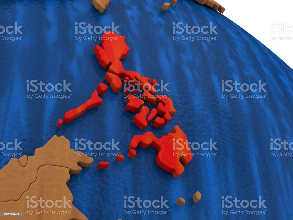 Philippines on wooden globe stock photo