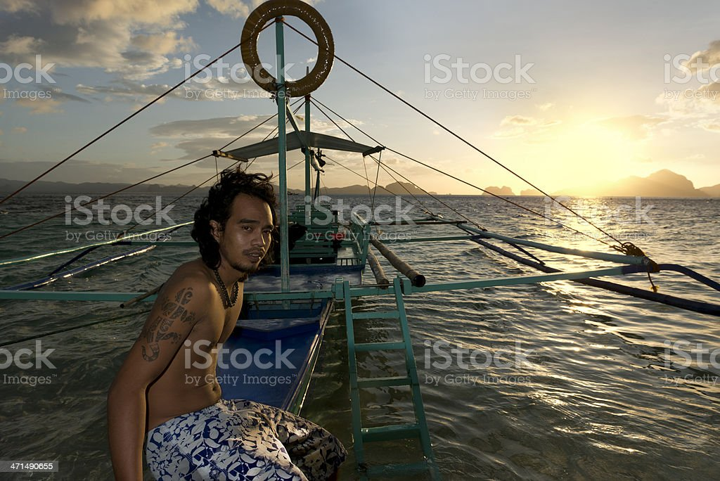 philippino with his traditional banca outrigger boats in the philippines royalty-free stock photo