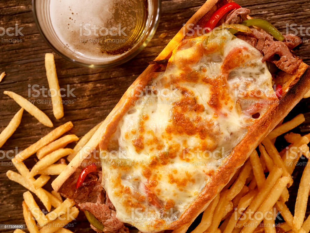 Philly Cheese Steak Sandwich with Fries and a Beer stock photo