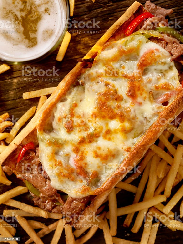 Philly Provolone, Cheese Steak Sandwich with Fries and a Beer stock photo