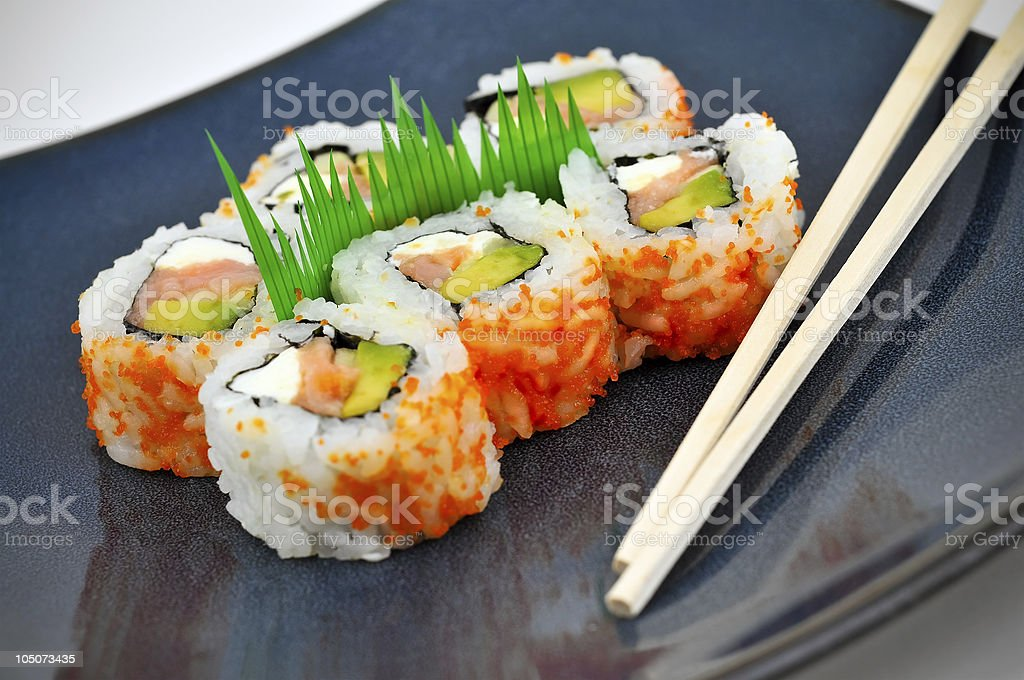 Philly Roll Sushi on Blue Plate with Chopsticks stock photo