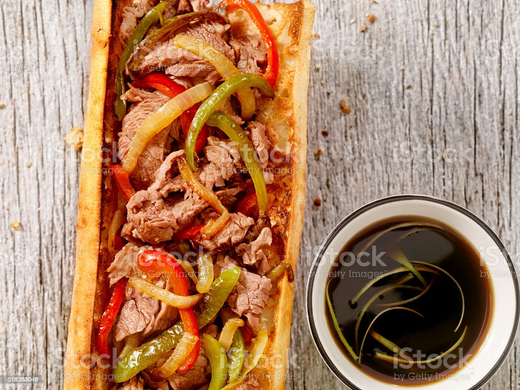 Philly Steak Sandwich with Peppers and Au Jus stock photo