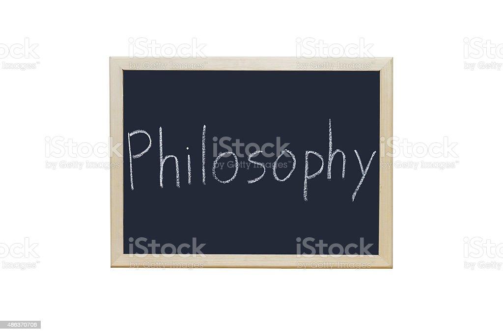 Philosophy written with white chalk on blackboard. stock photo