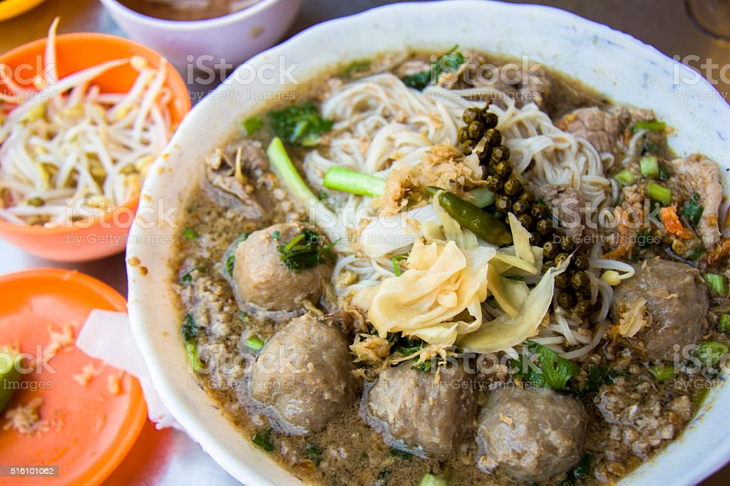Phnom Penh rice noodle soup with beef and beef ball stock photo