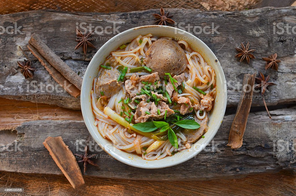 Pho Vietnamese beef soup on a wooden background stock photo