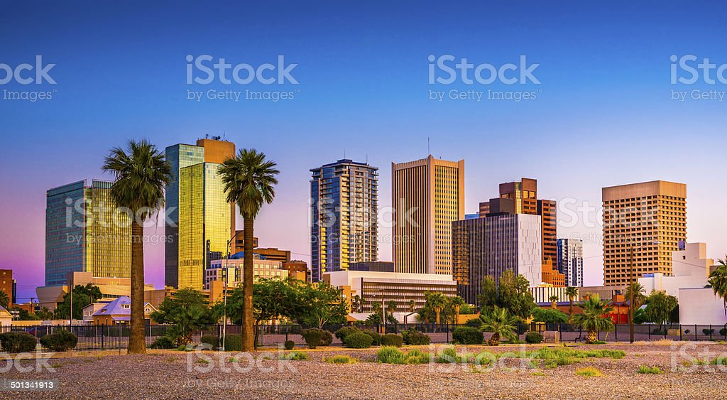 Phoenix Arizona downtown skyline skyscrapers, palm trees in tropical sunset stock photo