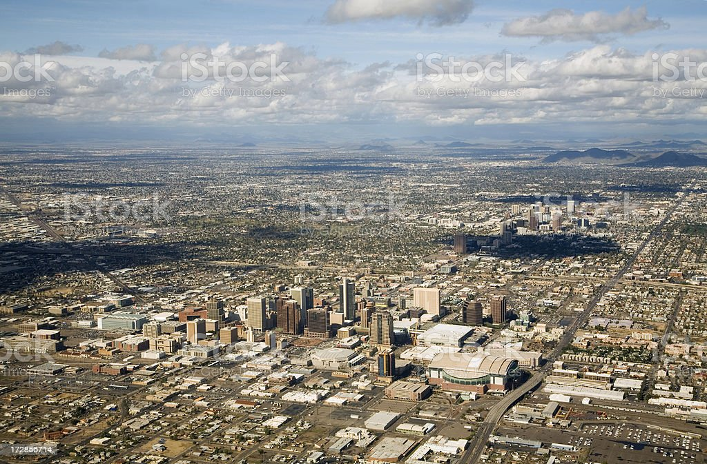 Phoenix, Arizona Skyline Aerial View with Downtown, Suburbs and Mountains stock photo