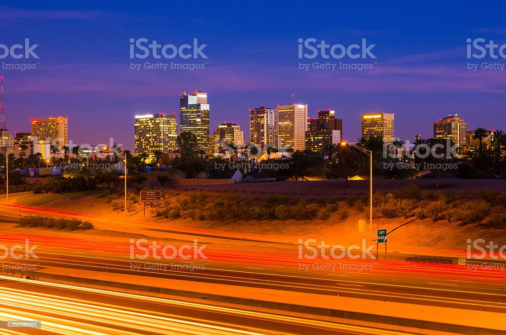 Phoenix skyline and freeway / highway at dusk stock photo