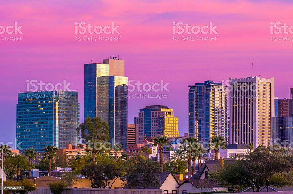 Phoenix Skyline at Dusk with Magenta and Purple Colored Clouds stock photo