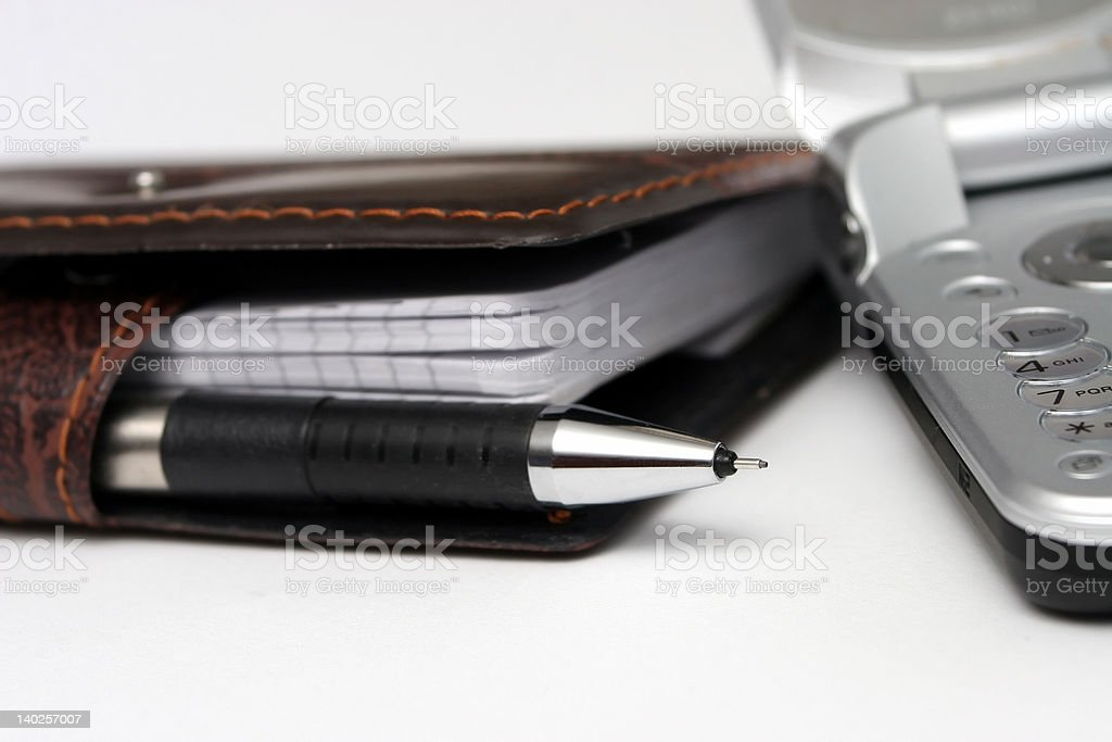 phone and agenda stock photo