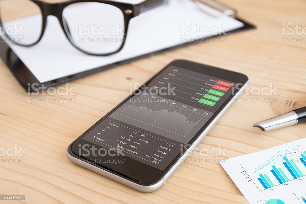 phone and business stock application on work desk stock photo