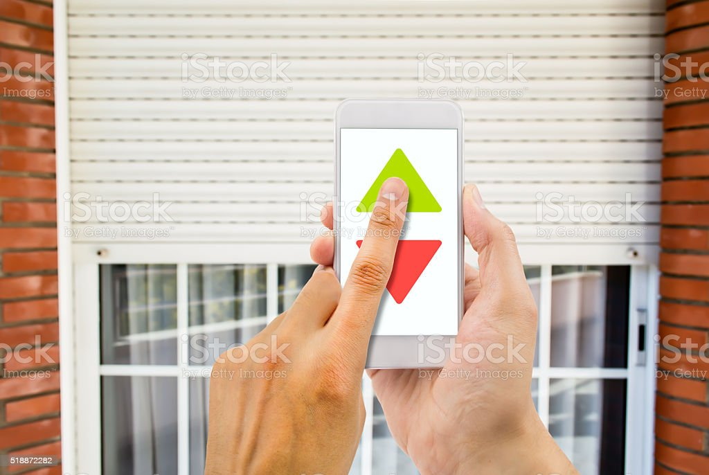 phone and electric roller shutter stock photo