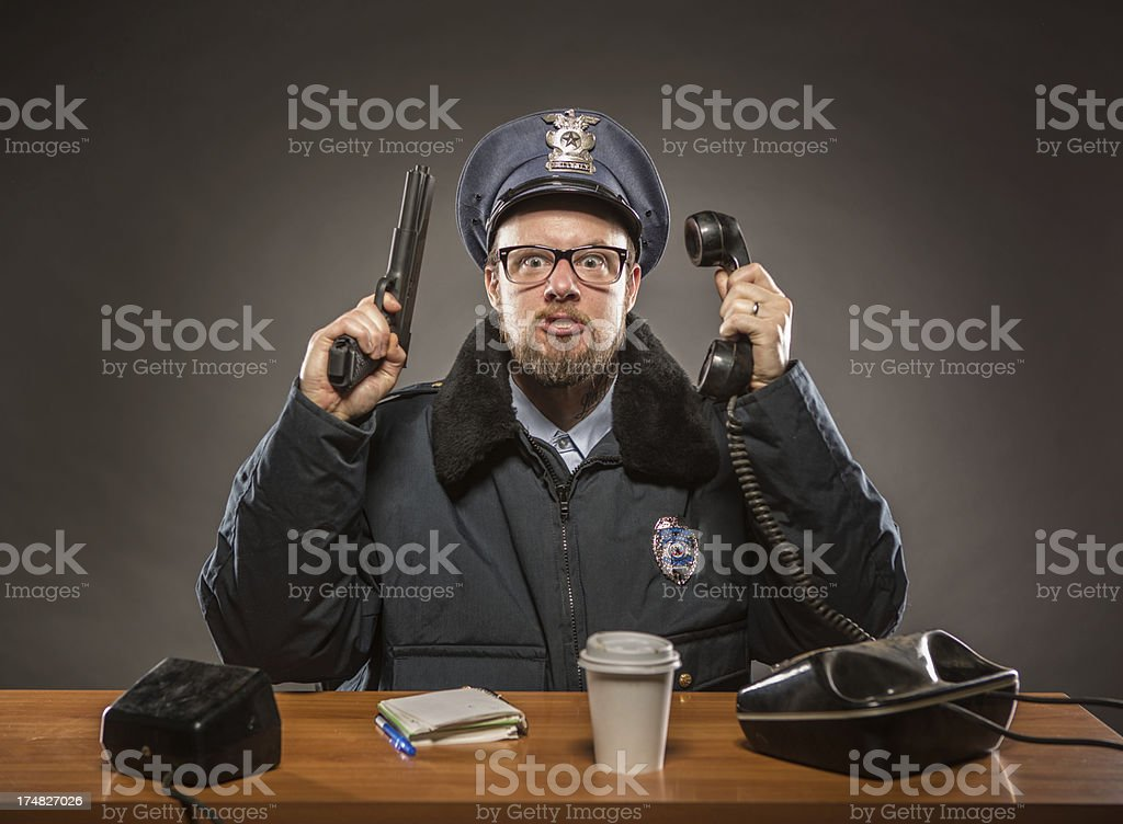 Phone and Gun in The Air:  Policeman royalty-free stock photo