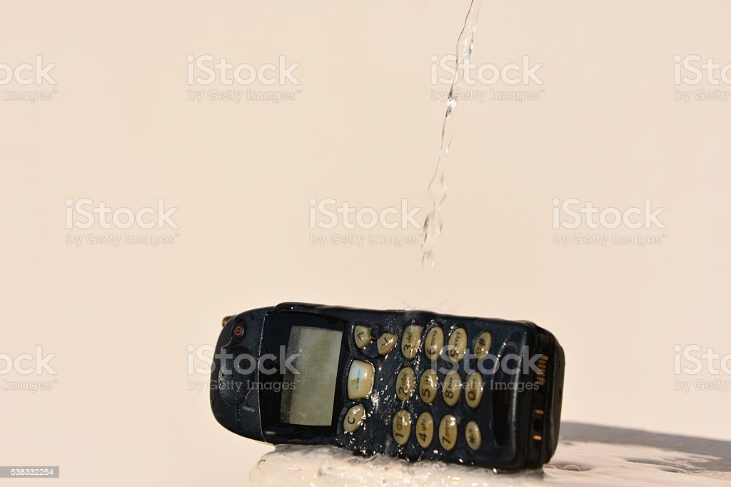 Phone and  water stock photo