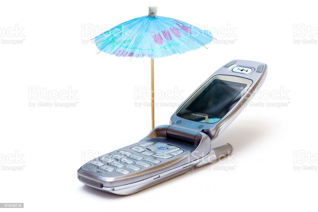Phone as chaise longue and umbrella royalty-free stock photo