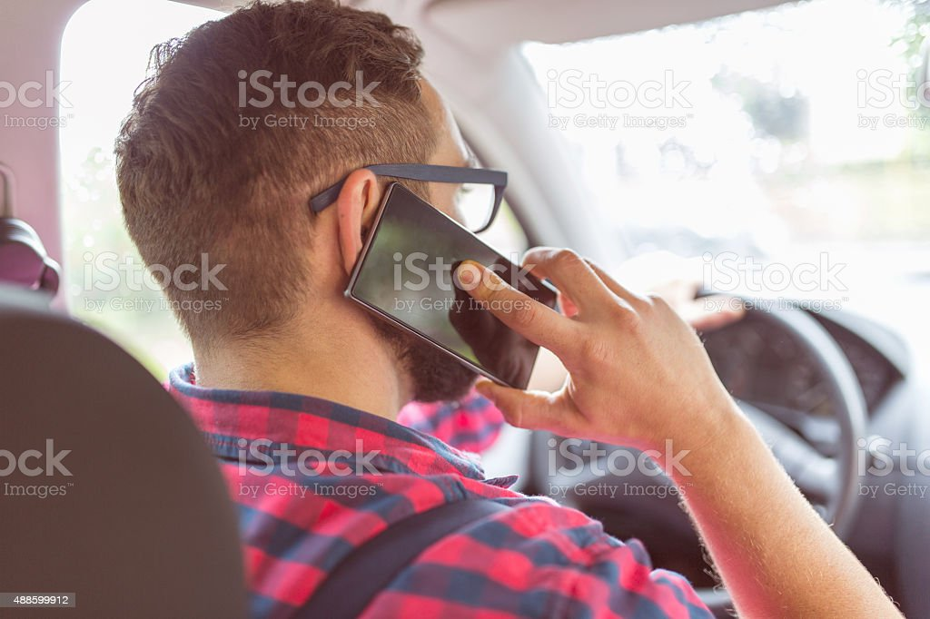 Phone call during driving stock photo