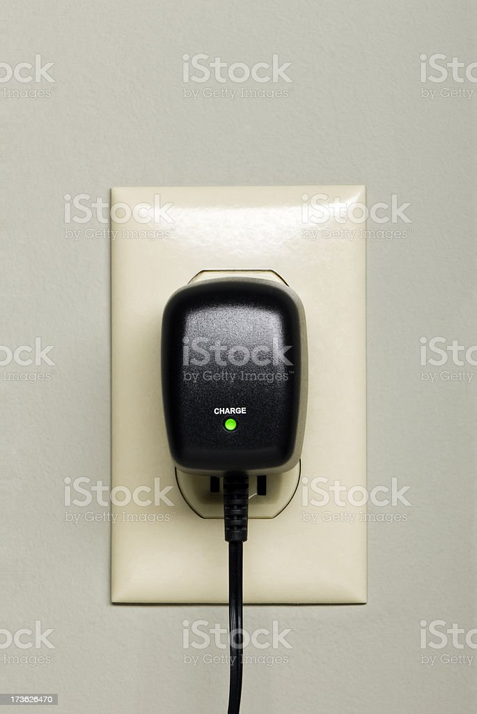 Phone Charger in Outlet stock photo