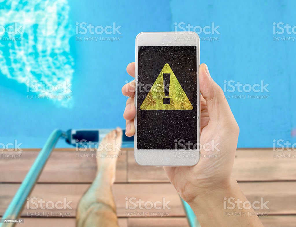 phone damaged by water stock photo