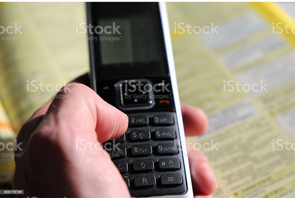 Phone directory with telephone stock photo