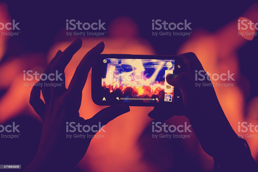 phone in the hands of women stock photo